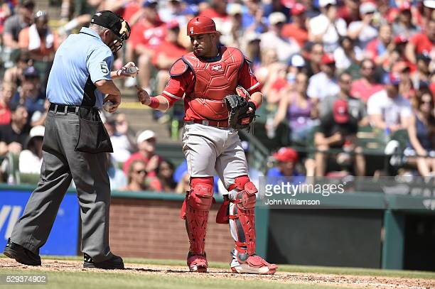 Geovany Soto of the Los Angeles Angels of Anaheim asks Umpire Dale Scott for a new ball during the game against the Texas Rangers at Globe Life Park...