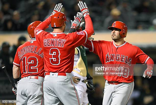 Geovany Soto of the Los Angeles Angels of Anaheim is congratulated by Yunel Escobar and Johnny Giavotella after Soto hit a tworun homer against the...