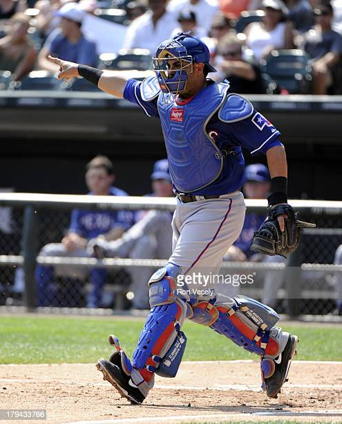 Geovany Soto of the Texas Rangers catches against the Chicago White Sox on August 25 2013 at US Cellular Field in Chicago Illinois The White Sox...