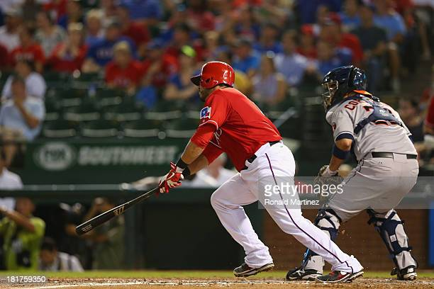 Geovany Soto of the Texas Rangers hits a onerun single against the Houston Astros in the fourth inning at Rangers Ballpark in Arlington on September...