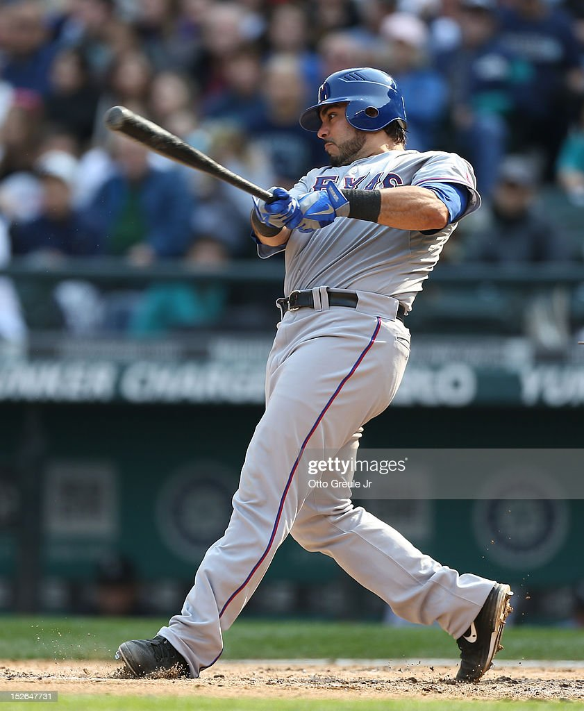 Geovany Soto #8 of the Texas Rangers hits a two-run homer in the fourth inning against the Seattle Mariners at Safeco Field on September 23, 2012 in Seattle, Washington.