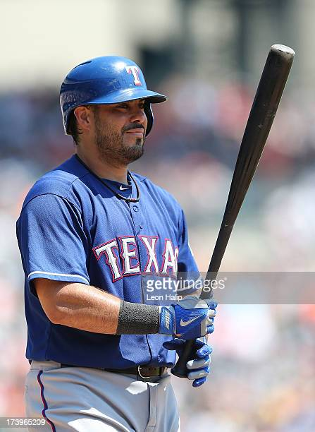 Geovany Soto of the Texas Rangers reacts after striking out in the third inning during the game against the Detroit Tigers at Comerica Park on July...