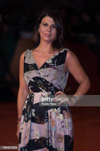 Geppi Cucciari walks the red carpet ahead of the 'Notti Magiche' screening during the 13th Rome Film Fest