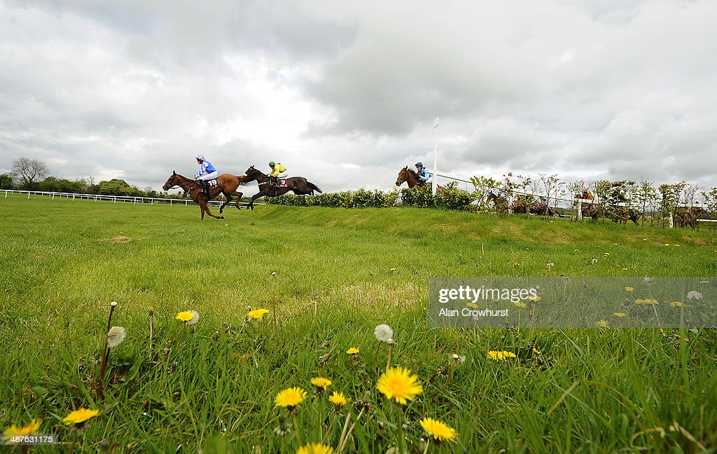Ger Fox riding Jacks Island (2L) clear the Galway Double before winning The Avon Ri Corporate & Leisure Resort Chase For The La Touche Cup at Punchestown racecourse on May 01, 2014 in Naas, Ireland.