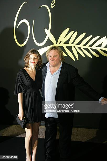 Gerad Depardieu and Clementine Igou arrive at the anniversary dinner for the 60th Cannes Film Festival