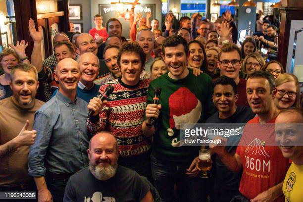 Geraint Thomas and Luke Rowe of Team Ineos pose with the audience of their Podcast 'Watts Occuing' at The Halfway Public House on December 27, 2019...