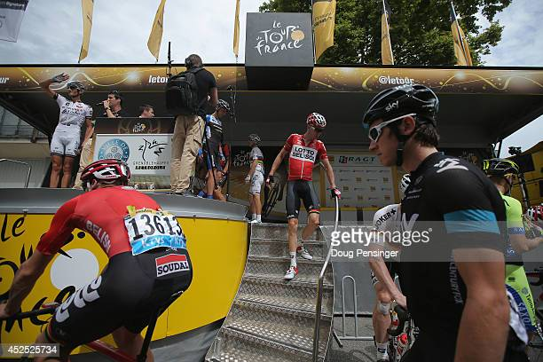 Geraint Thomas of Great Britain and Team Sky and Adam Hansen of Australia and Lotto Belisol arrive at sign in for the fourteenth stage of the 2014...