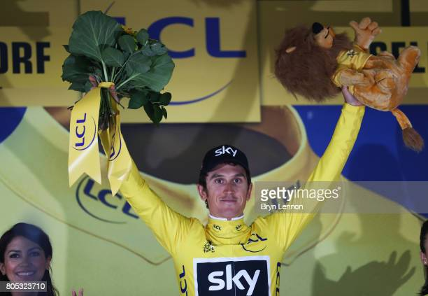 Geraint Thomas of Great Britain and Team Sky celebrates securing the yellow jersey follwing victory during stage one of Le Tour de France 2017 a 14km...
