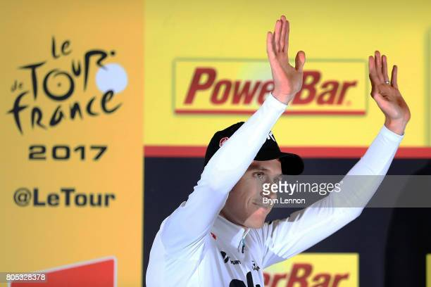 Geraint Thomas of Great Britain and Team SKY celebrates winning the first stage and taking the race leaders yellow jersey after stage one of the 2017...