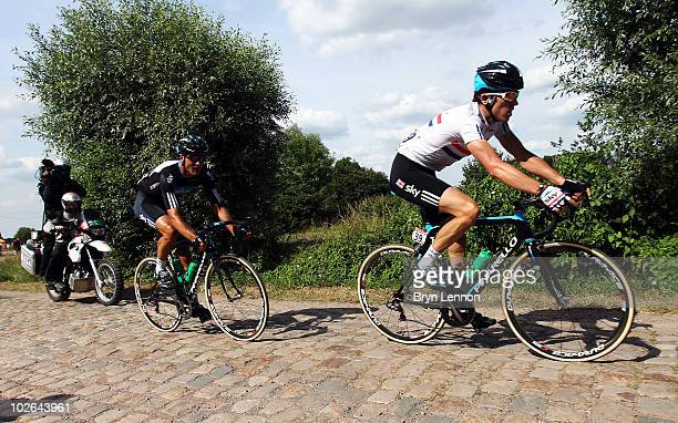 Geraint Thomas of Great Britain and Team SKY leads team mate Steve Cummings over the cobbles during stage three of the 2010 Tour de France from Wanze...