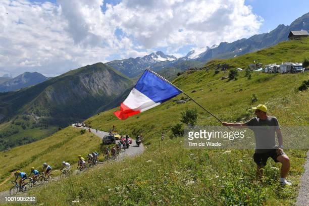 Geraint Thomas of Great Britain and Team Sky Yellow Leader Jersey / Col De La Croix De Fer / Landscape / Mountains / Fans / Public / Peloton / during...
