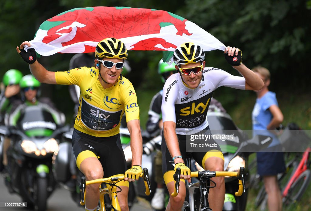 Geraint Thomas of Great Britain and Team Sky Yellow Leader Jersey / Luke Rowe of Great Britain and Team Sky / Celebration / Wales flag / during the 105th Tour de France 2018, Stage 21 a 116km stage from Houilles to Paris Champs-Elysees / TDF / on July 29, 2018 in Paris, France.