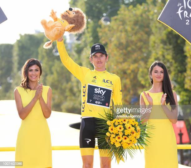 Geraint Thomas of Great Britain celebrates on the podium after winning the Tour de France in Paris France on July 29 2018