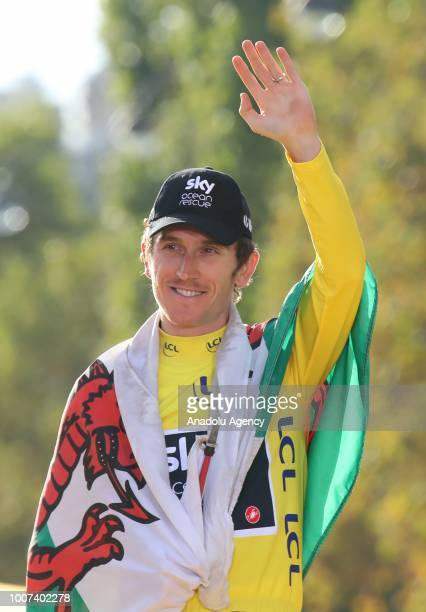 Geraint Thomas of Great Britain celebrates on the podium after winning the Tour de France in Paris, France on July 29, 2018.