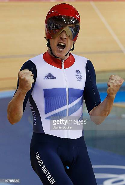 Geraint Thomas of Great Britain celebrates winning gold and setting a new world record after the Men's Team Pursuit Track Cycling final on Day 7 of...