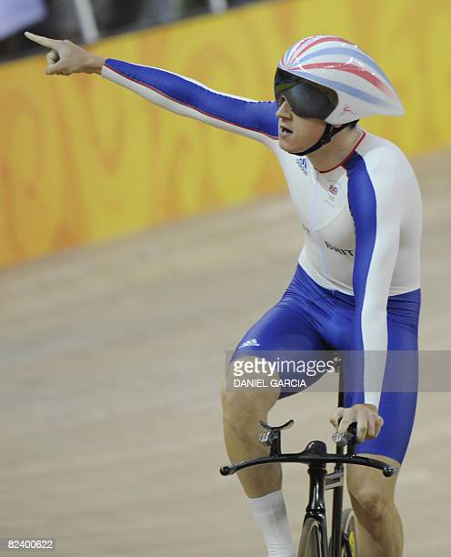 Geraint Thomas of the track cycling team of Great Britain, celebrates after winning the gold medal in the 2008 Beijing Olympic Games men's team...