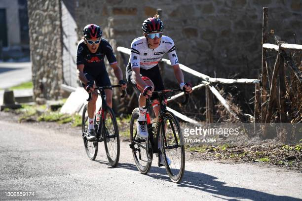 Geraint Thomas of The United Kingdom and Team INEOS Grenadiers & Tadej Pogacar of Slovenia and UAE Team Emirates White Best Young Rider Jersey during...
