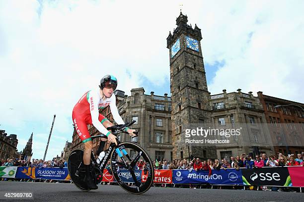 Geraint Thomas of Wales goes past The Tolbooth during the Men's individual time trial during day eight of the Glasgow 2014 Commonwealth Games on July...