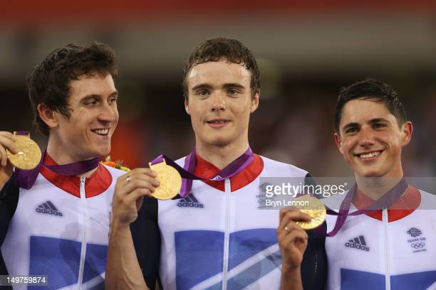 Geraint Thomas Steven Burke and Peter Kennaugh of Great Britain celebrate with their gold medals during the medal ceremony for the Men's Team Pursuit...