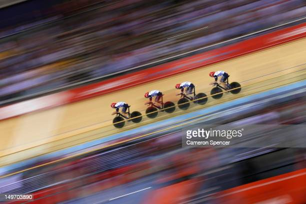Geraint Thomas Steven Burke Edward Clancy and Peter Kennaugh of Great Britain post a new world record time during Men's Team Pursuit Track Cycling...