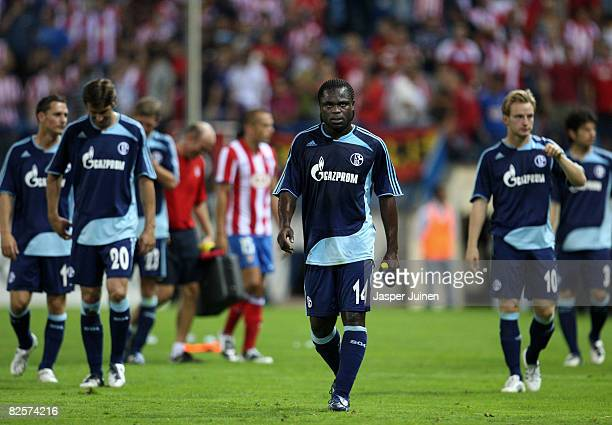 Gerald Asamoah of FC Schalke walks off the pitch dejected with his teammates at the end of the UEFA Champions League third Qualifying Round second...