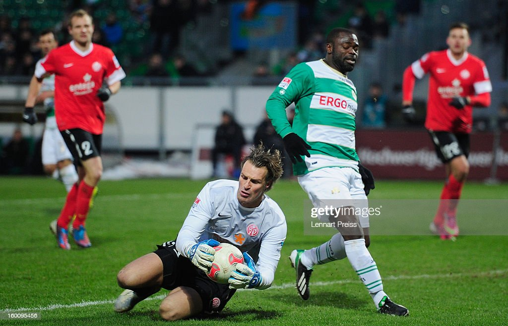 Gerald Asamoah (R) of Fuerth challenges Christian Wetklo of Mainz during the Bundesliga match between SpVgg Greuther Fuerth and 1. FSV Mainz 05 at Trolli-Arena on January 26, 2013 in Fuerth, Germany.