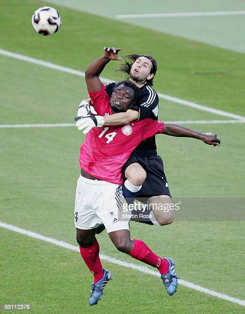 Gerald Asamoah of Germany competes with German Lux of Argentina during the FIFA Confederations Cup 2005 match between Argentina and Germany at the...