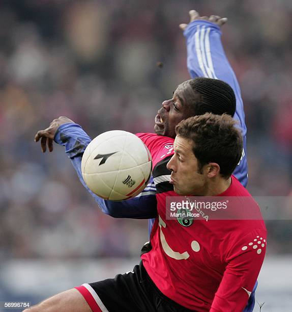 Gerald Asamoah of Schalke and Steven Cherundolo of Hannover fight for the ball during the Bundesliga match between Hanover 96 and FC Schalke 04 at...