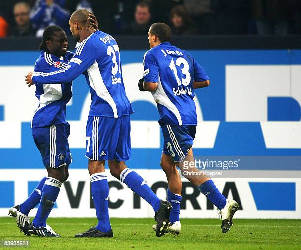 Gerald Asamoah of Schalke celebrates his goal with Orlando Engelaar during the Bundesliga match between FC Schalke 04 and Hertha BSC Berlin at the...