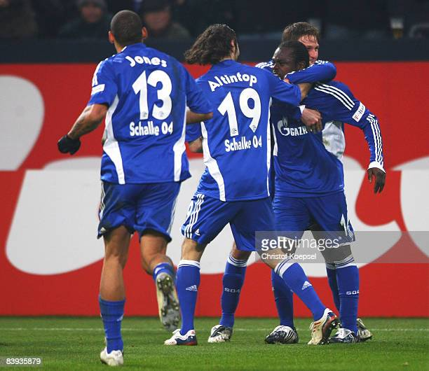 Gerald Asamoah of Schalke celebrates the first goal with Benedikt Hoewedes , Halil Altintop and Jermaine Jones during the Bundesliga match between FC...