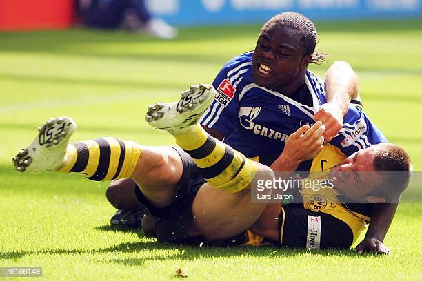 Gerald Asamoah of Schalke in action with Robert Kovac of Dortmund during the Bundesliga match between Schalke 04 and Borussia Dortmund at the Veltins...