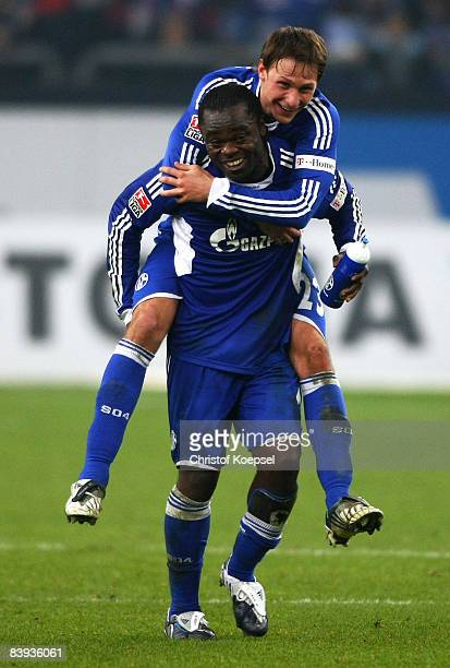 Gerald Asamoah of Schalke who has scored the decision goal celebrates the 1-0 victory with Benedikt Hoewedes after the Bundesliga match between FC...