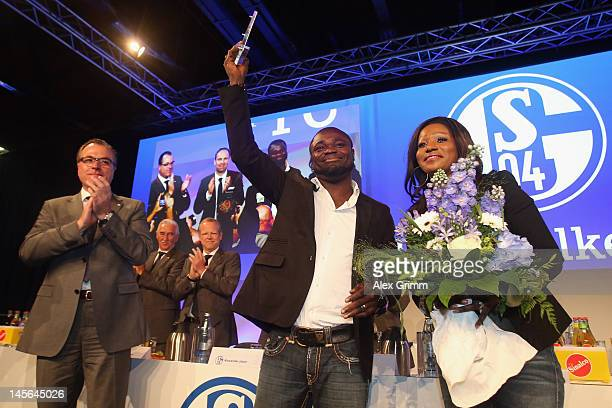 Gerald Asamoah reacts with his wife Linda and Schalke CEO Clemens Tonnies after being awarded member of the Schalke 'Hall of fame' during the annual...