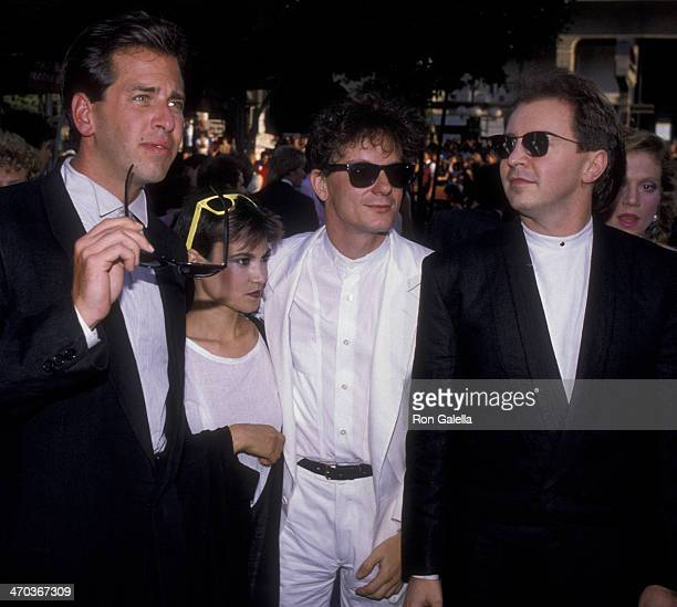 Gerald Casale Mark Mothersbaugh and Bob Casale of Devo attend the premiere of 'Purple Rain' on July 26 1984 at Mann Chinese Theater in Hollywood...
