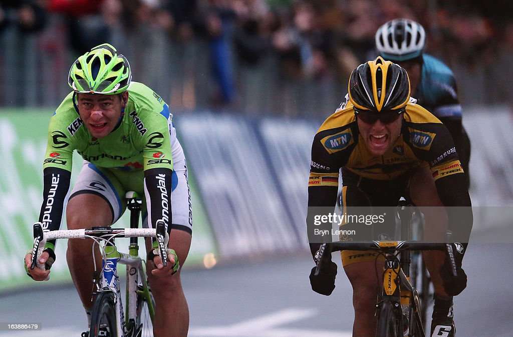 Gerald Ciolek of Germany and MTN Qhubeka (R) reacts to winning after beating beat Peter Sagan of Slovakia and Canondale across the finish line during the 2013 Milan - San Remo on March 17, 2013 in San Remo, Italy.