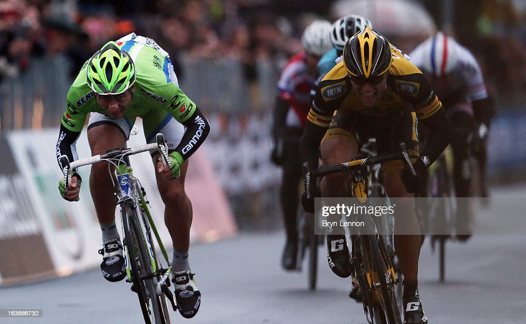 Gerald Ciolek (r) of Germany and MTN Qhubeka sprints against Peter Sagan of Slovakia and Cannondale at the finish line during the 2013 Milan - San Remo on March 17, 2013 in San Remo, Italy.