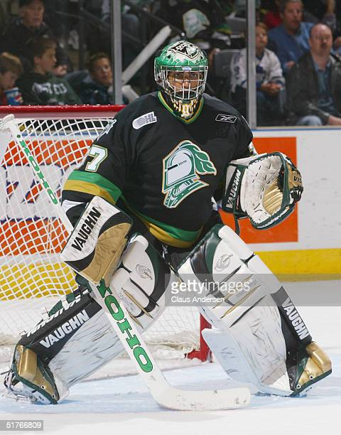 Gerald Coleman of the London Knights defends the net against the Owen Sound Attack during an OHL game at the John Labatt Center on October 15 2004 in...