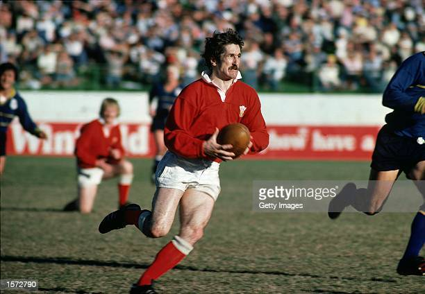 Gerald Davies of Wales runs with the ball during the Welsh tour to Australia Mandatory Credit AllsportUK /Allsport