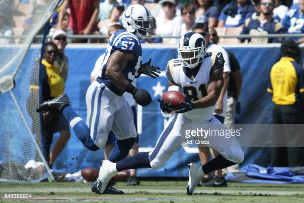 Gerald Everett of the Los Angeles Rams catches a pass against Jon Bostic of the Indianapolis Colts during the second quarter at Los Angeles Memorial...