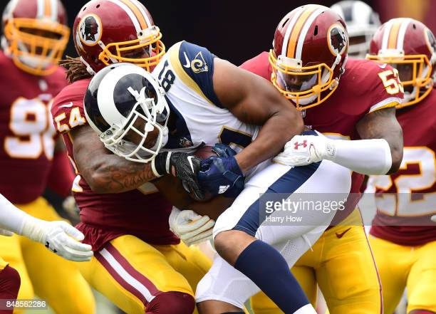 Gerald Everett of the Los Angeles Rams is tackled by Mason Foster and Zach Brown of the Washington Redskins during the first quarter at Los Angeles...