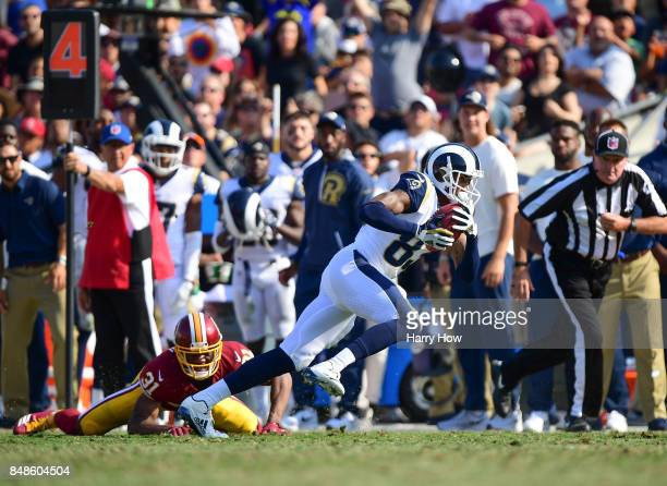 Gerald Everett of the Los Angeles Rams makes a catch over Fabian Moreau of the Washington Redskins on a fake punt during the fourth quarter at Los...