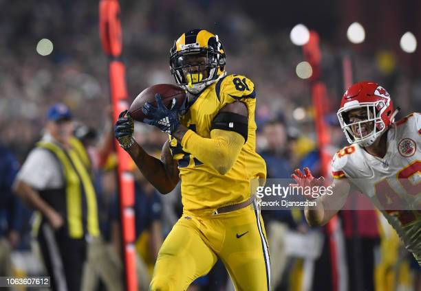 Gerald Everett of the Los Angeles Rams makes a touchdown catch in front of Daniel Sorensen of the Kansas City Chiefs during the fourth quarter of the...