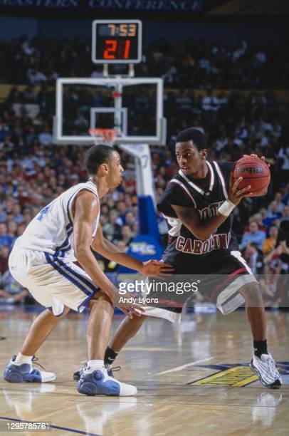 Gerald Fitch, Guard for the University of Kentucky Wildcats fixes his eyes and stares at Michael Boynton of the University of South Carolina...
