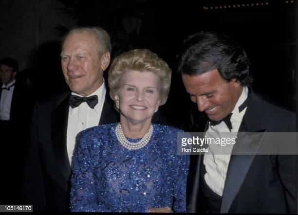 Gerald Ford Betty Ford and Julio Iglesias during The Opening Of The Stouffer Concourse Hotel at Stouffer Concourse Hotel in Los Angeles CA United...