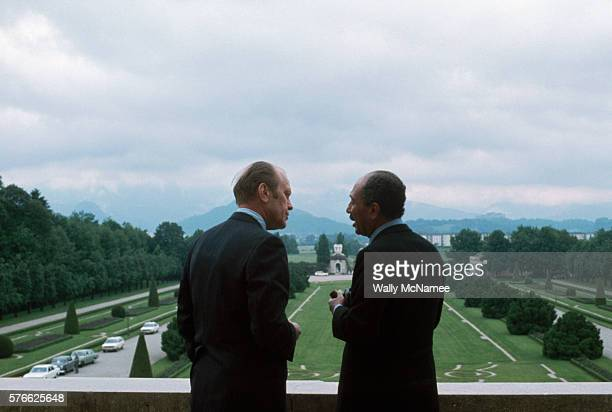 Gerald Ford talks with Egyptian President Anwar elSadat on the balcony of an Austrian palace