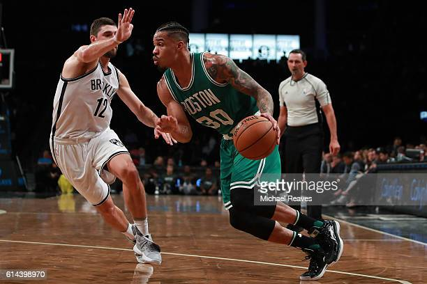 Gerald Green of the Boston Celtics drives to the basket defended by Joe Harris of the Brooklyn Nets during the second half of the preseason game at...