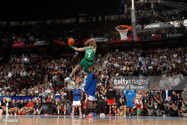Gerald Green of the Boston Celtics dunks over Nate Robinson of the New York Knicks in the Sprite Slam Dunk Competition at NBA All-Star Weekend at the...