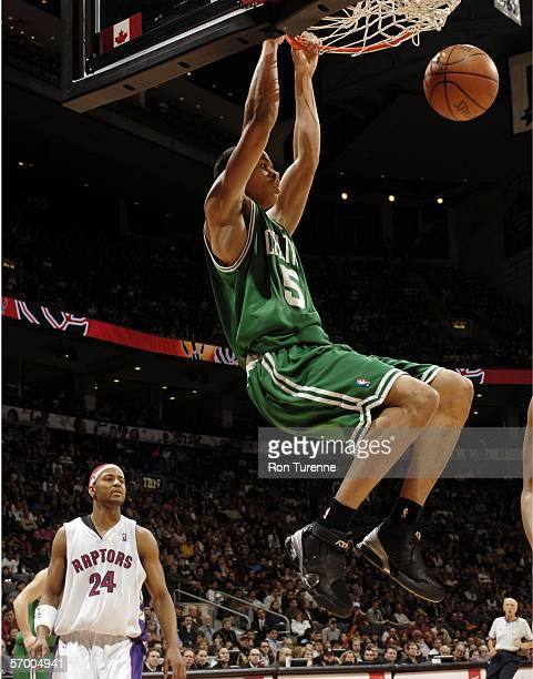 Gerald Green of the Boston Celtics dunks the ball in front of Morris Peterson of the Toronto Raptors on March 5 2006 at the Air Canada Centre in...