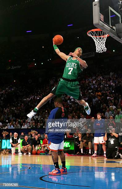 Gerald Green of the Boston Celtics leaps over fellow competitor Nate Robinson of the New York Knicks in the Sprite Slam Dunk Competition during NBA...
