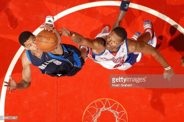 Gerald Green of the Dallas Mavericks and Marcus Camby of the Los Angeles Clippers reach for the ball during their game at Staples Center on November...
